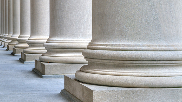 Base of several pillars outside of a capital building